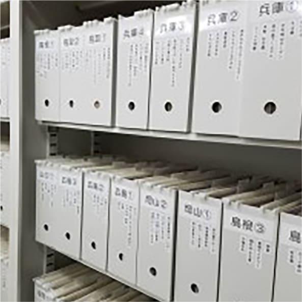 Well organized document shelf.